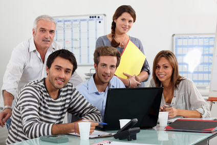 Class and teacher gatherd around laptop